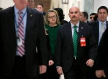 Secretary of State Hillary Rodham Clinton, center, flanked by security and staff, arrives on Capitol Hill in Washington, Wednesday, Jan. 23, 2013, to testify before the House Foreign Affairs Committee hearing on the deadly September attack on the U.S. diplomatic mission in Benghazi, Libya, that killed Ambassador Chris Stevens and three other Americans. (AP Photo/Manuel Balce Ceneta)